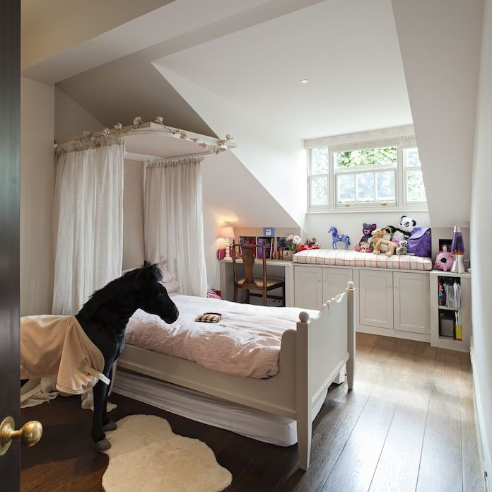 Rustic girl's room with canopy bed.