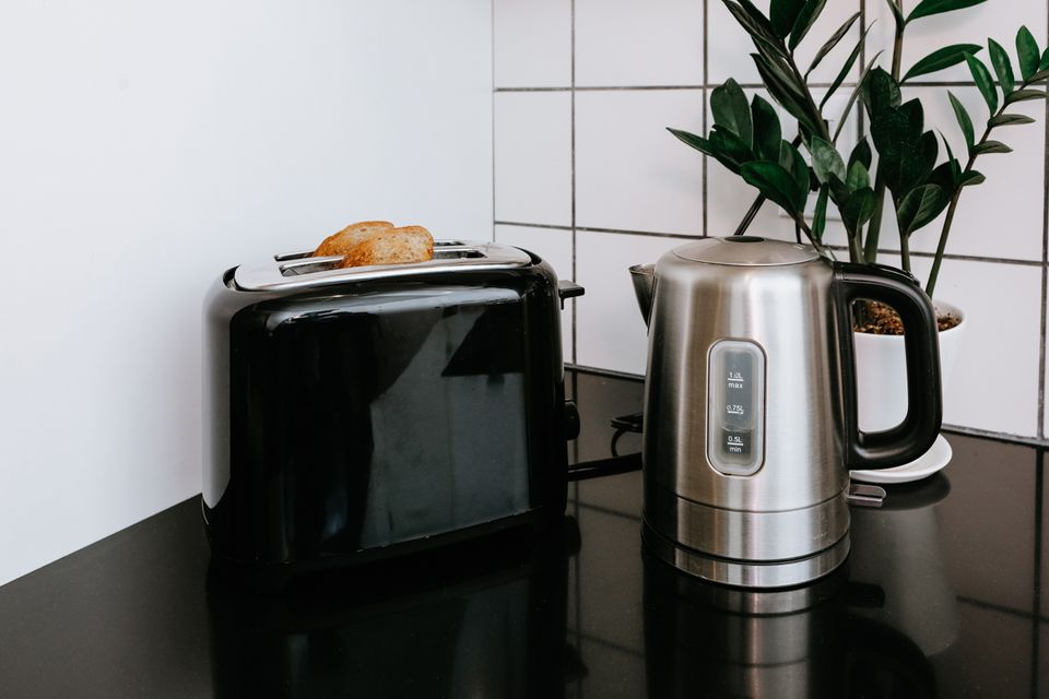 a toaster and kettle on a countertop