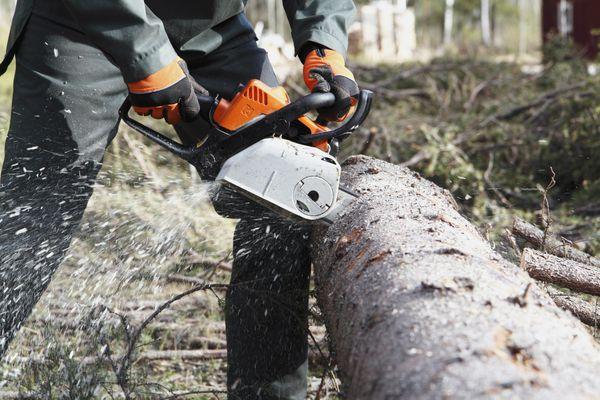 man-using-chainsaw