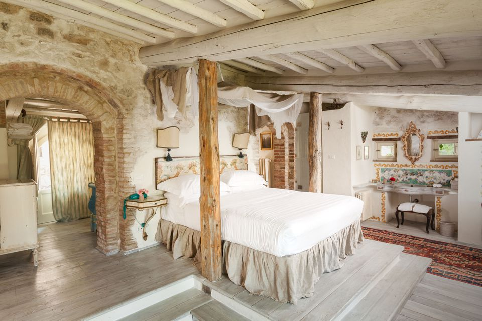 Tuscan bedroom with ensuite bathroom.