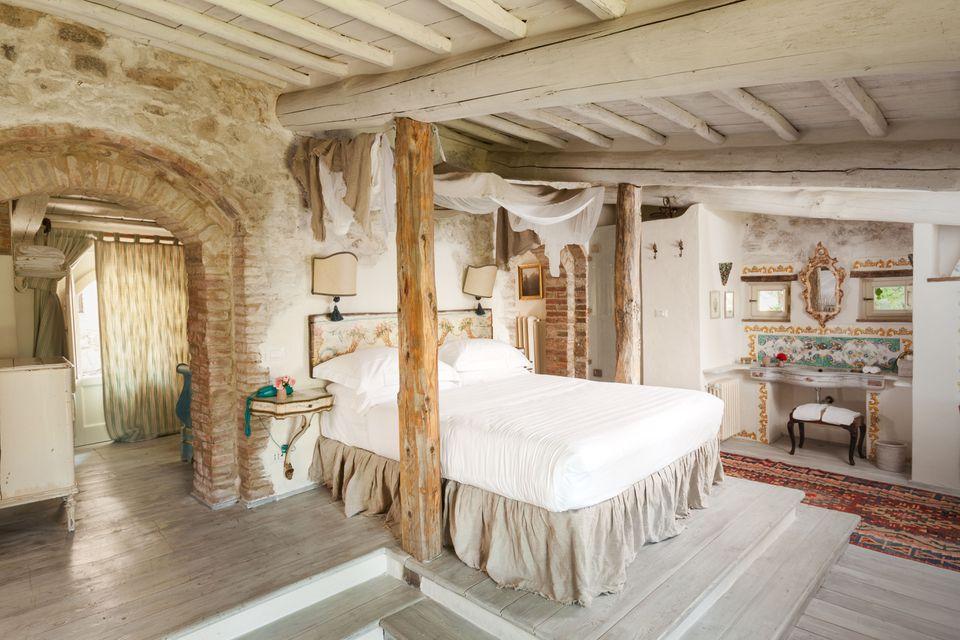 Tuscan bedroom with ensuite bathroom.