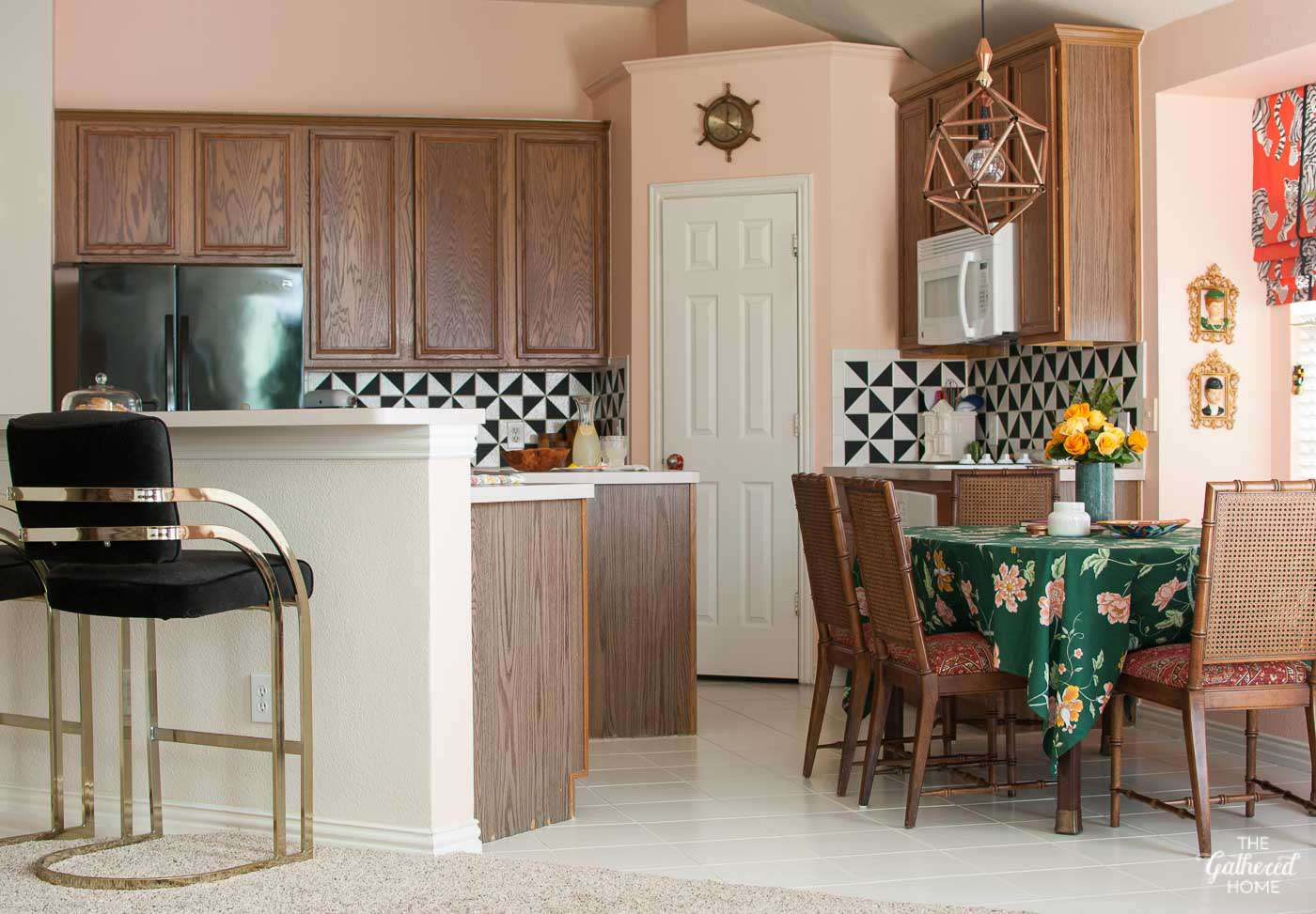 kitchen with wood cabinets and pink walls