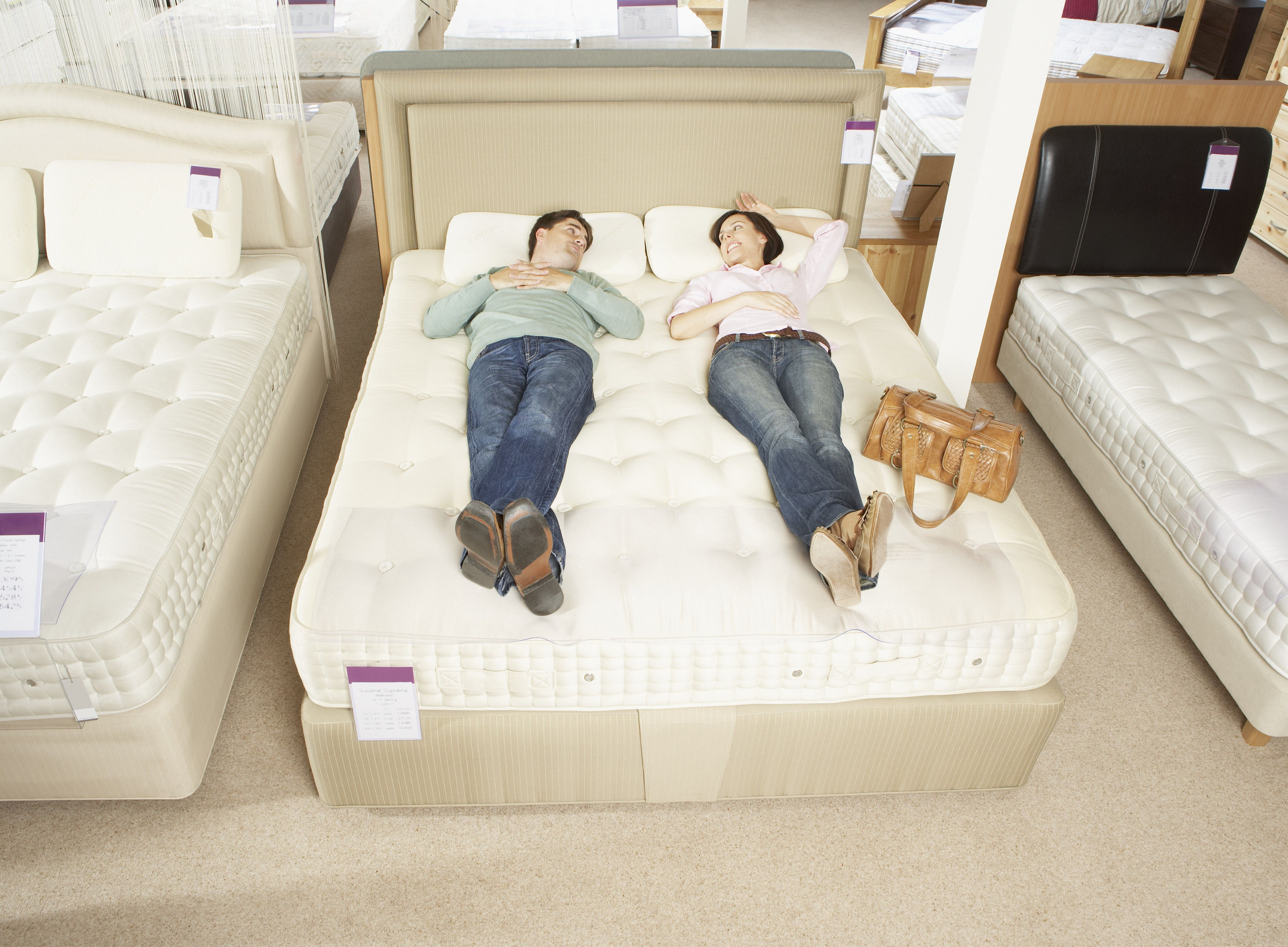 Couple trying out a new mattress
