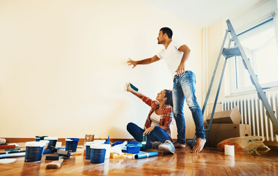 Couple getting ready to paint their apartment