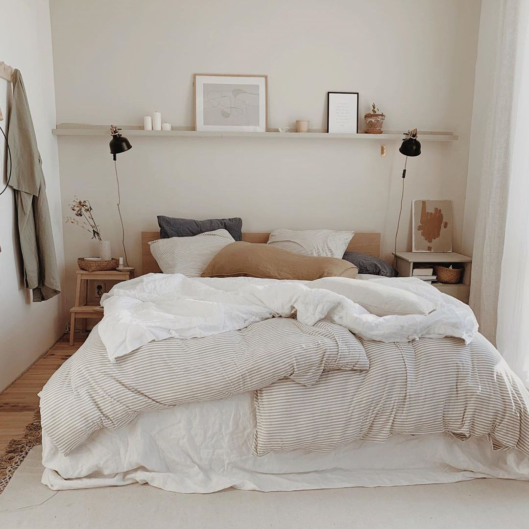 Bed with light-colored bedding