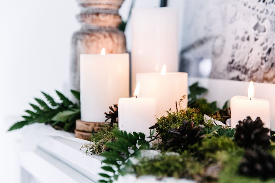 white candles on a mantel - 2017 feng shui