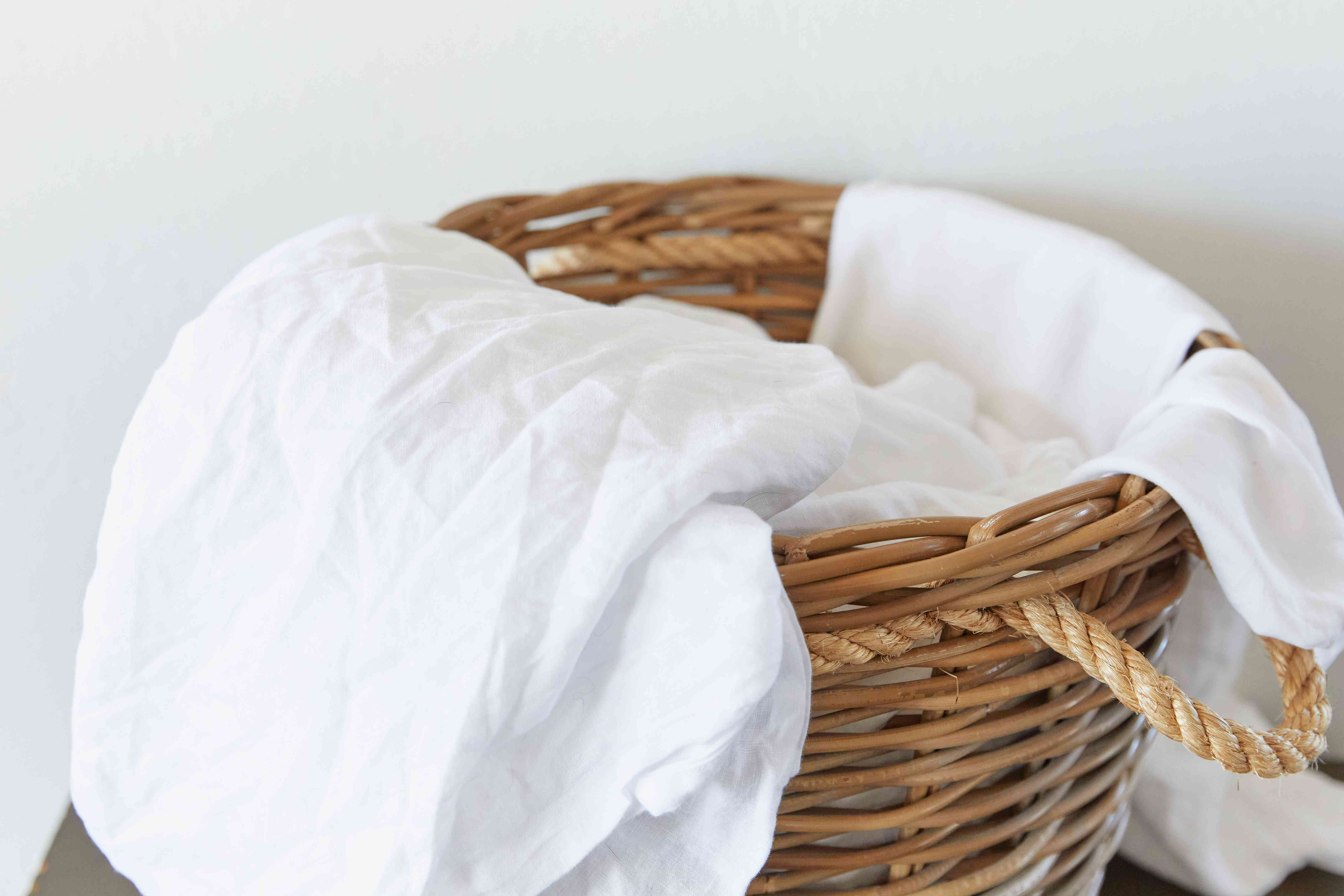 used linens in a laundry basket