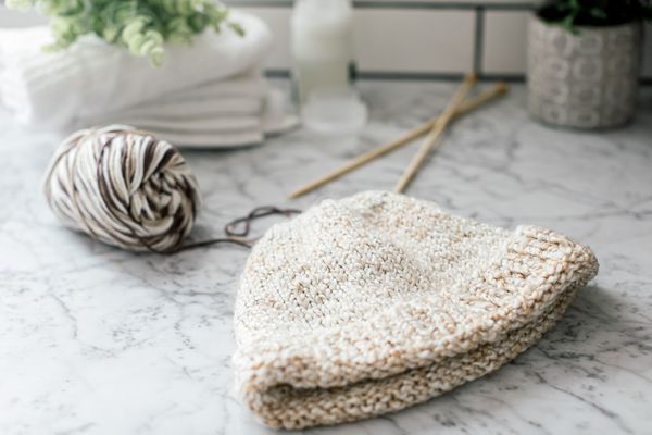 A hand-knit hat and a ball of yarn