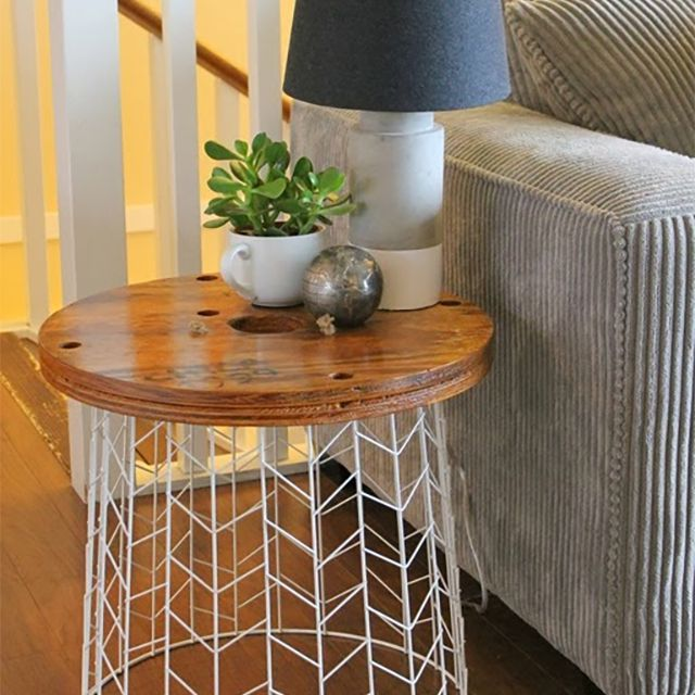 An end table with a metal white bottom and wood top