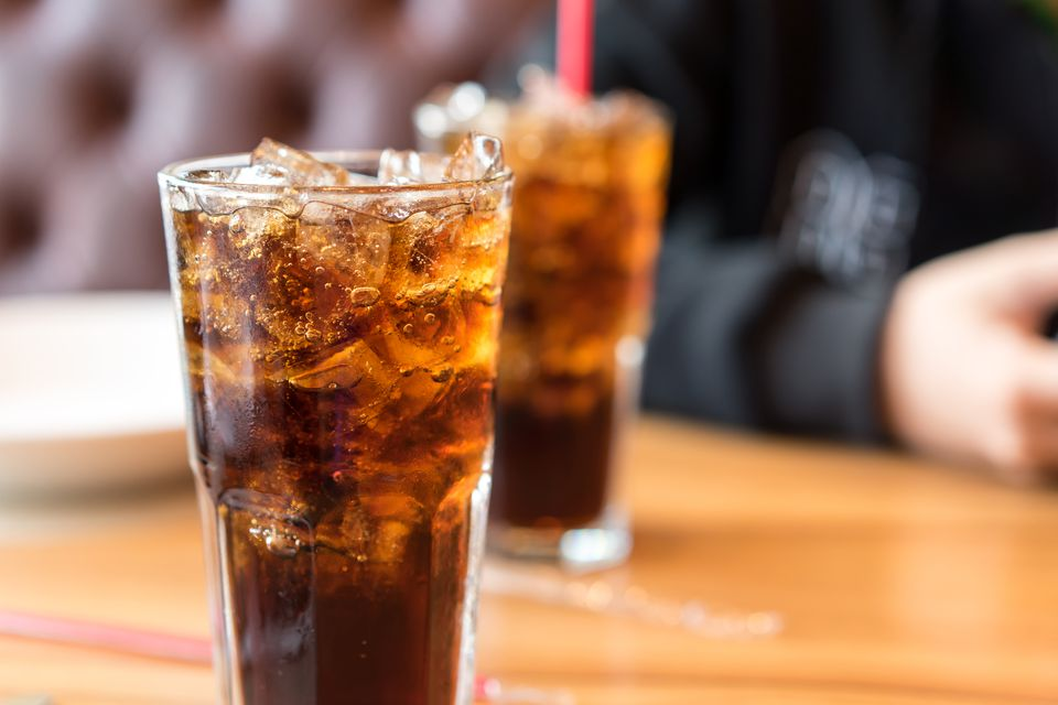 Soft drinks on wooden table