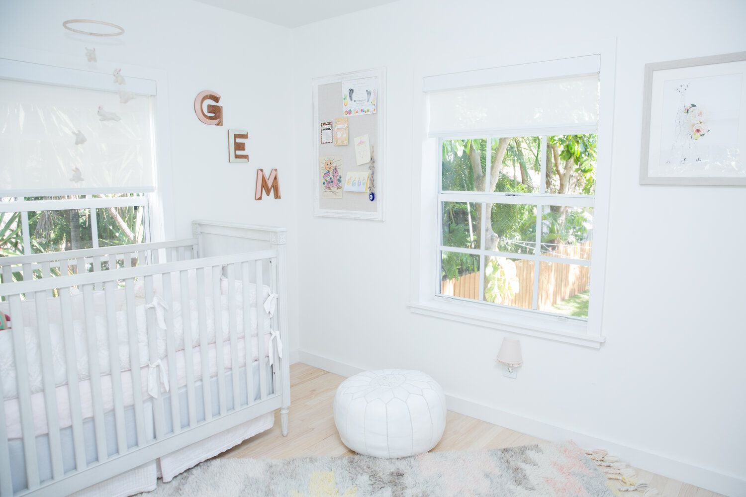 white nursery with open windows and plenty of natural light