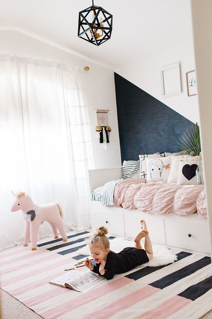 Contemporary, black and white girl's room with pink accents