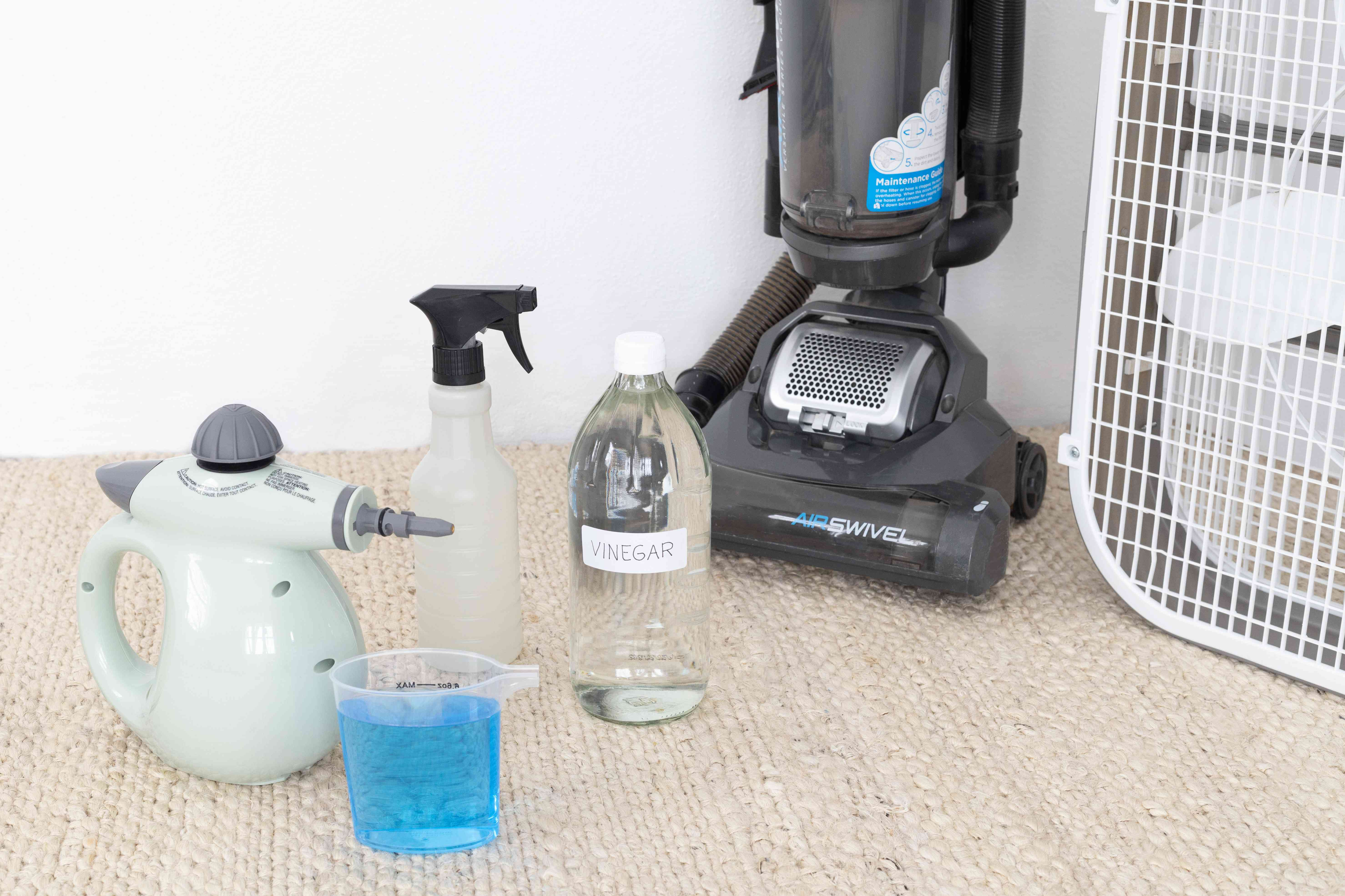 Cleaning solutions and vacuum on carpet