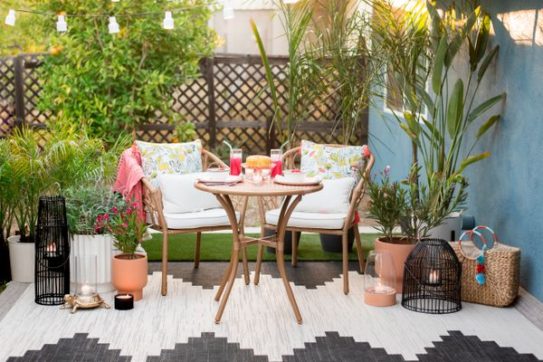 Small outdoor dining area with plants