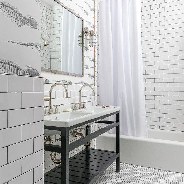 A kid's black and white fossil-themed bathroom