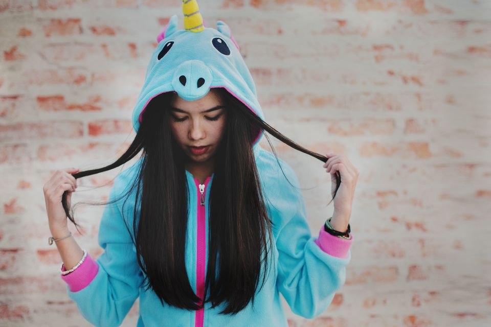 girl wearing unicorn pajamas