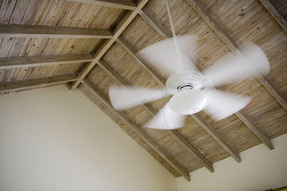 Fan rotating in a room
