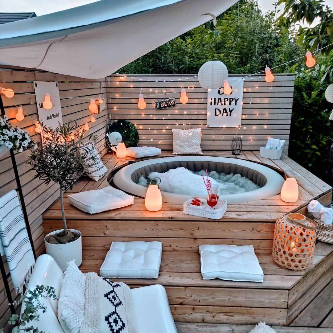 A backyard with an inflatable pool surrounded by a wood deck.