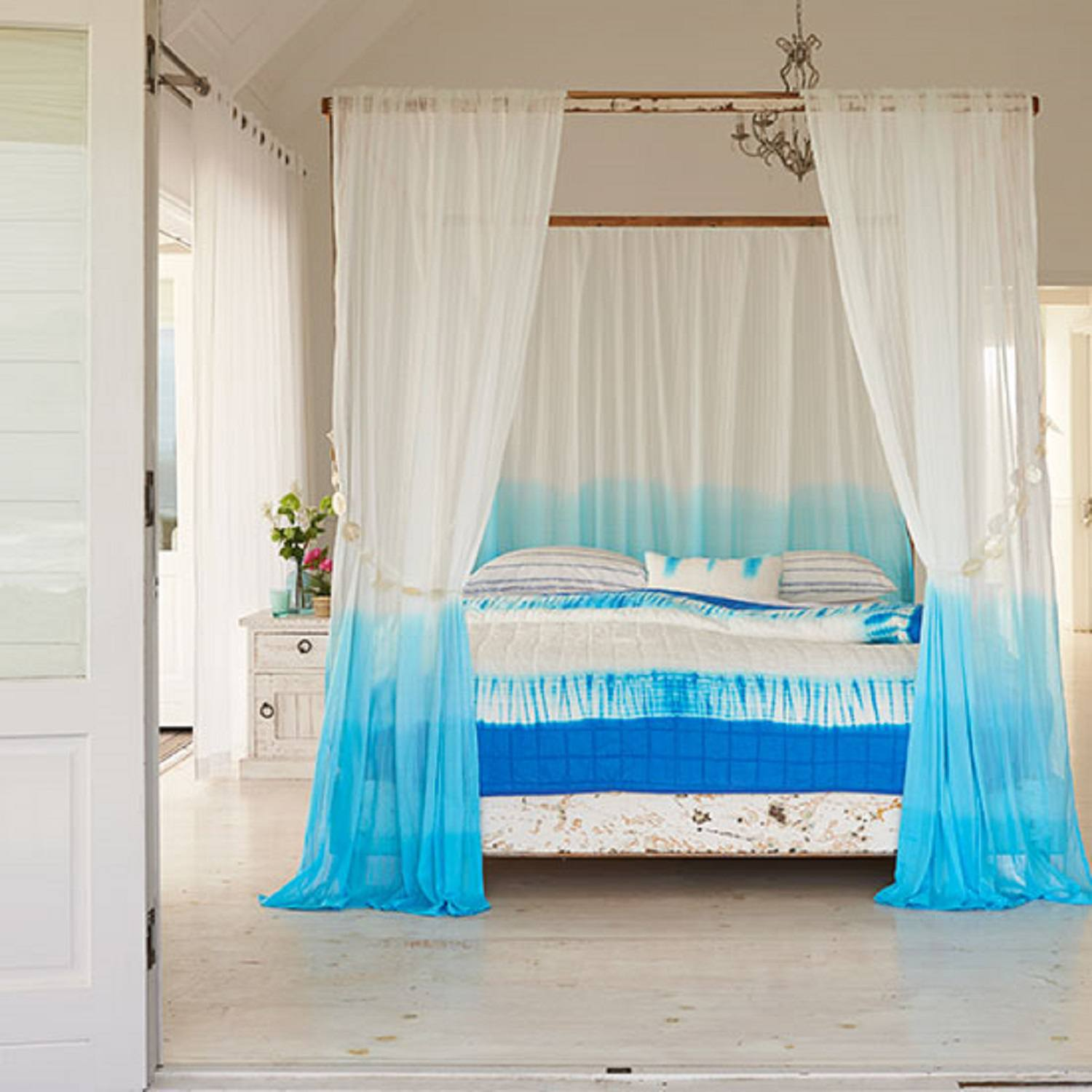 Dip-dyed canopy around bed