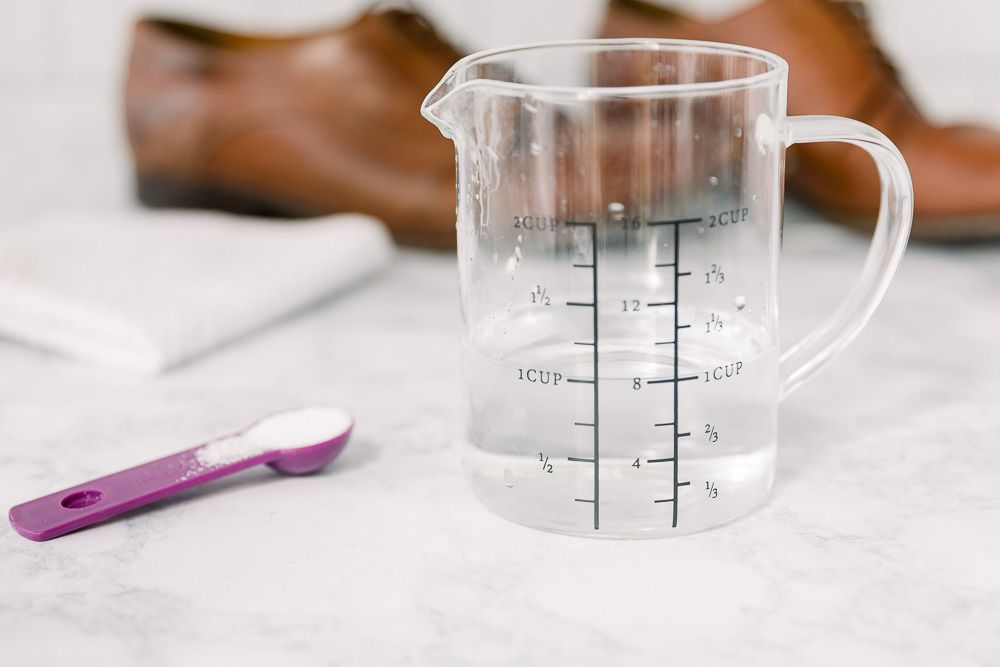 A measuring cup of oxygen bleach solution