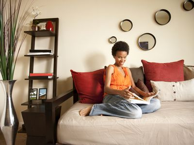 Woman sitting on futon
