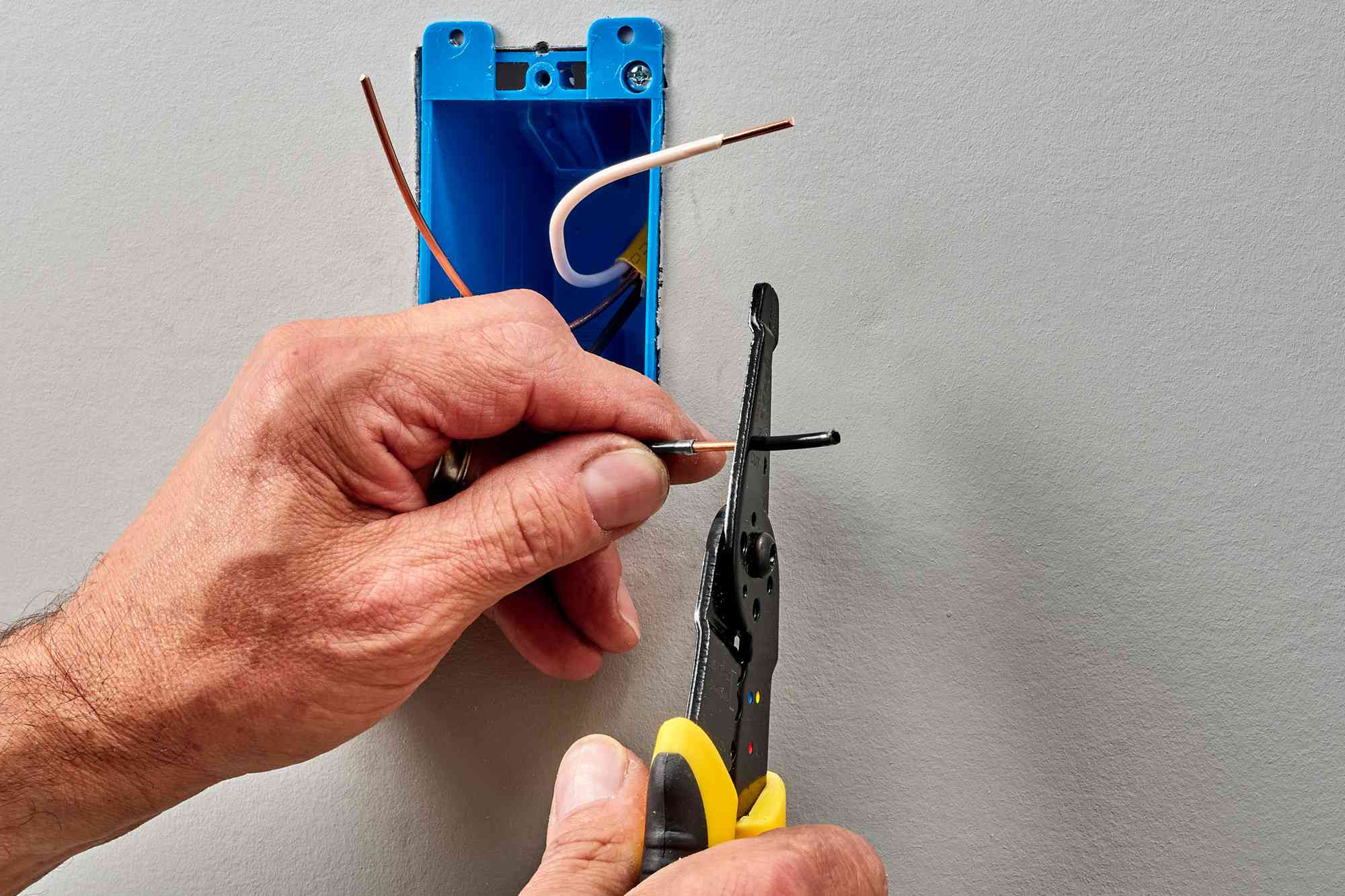 Insulation from circuit wire being stripped with wire stripper