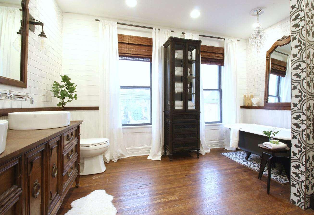 Updated attic bathroom with farmhouse decor and wood floors.