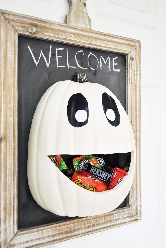 A pumpkin sign with candy