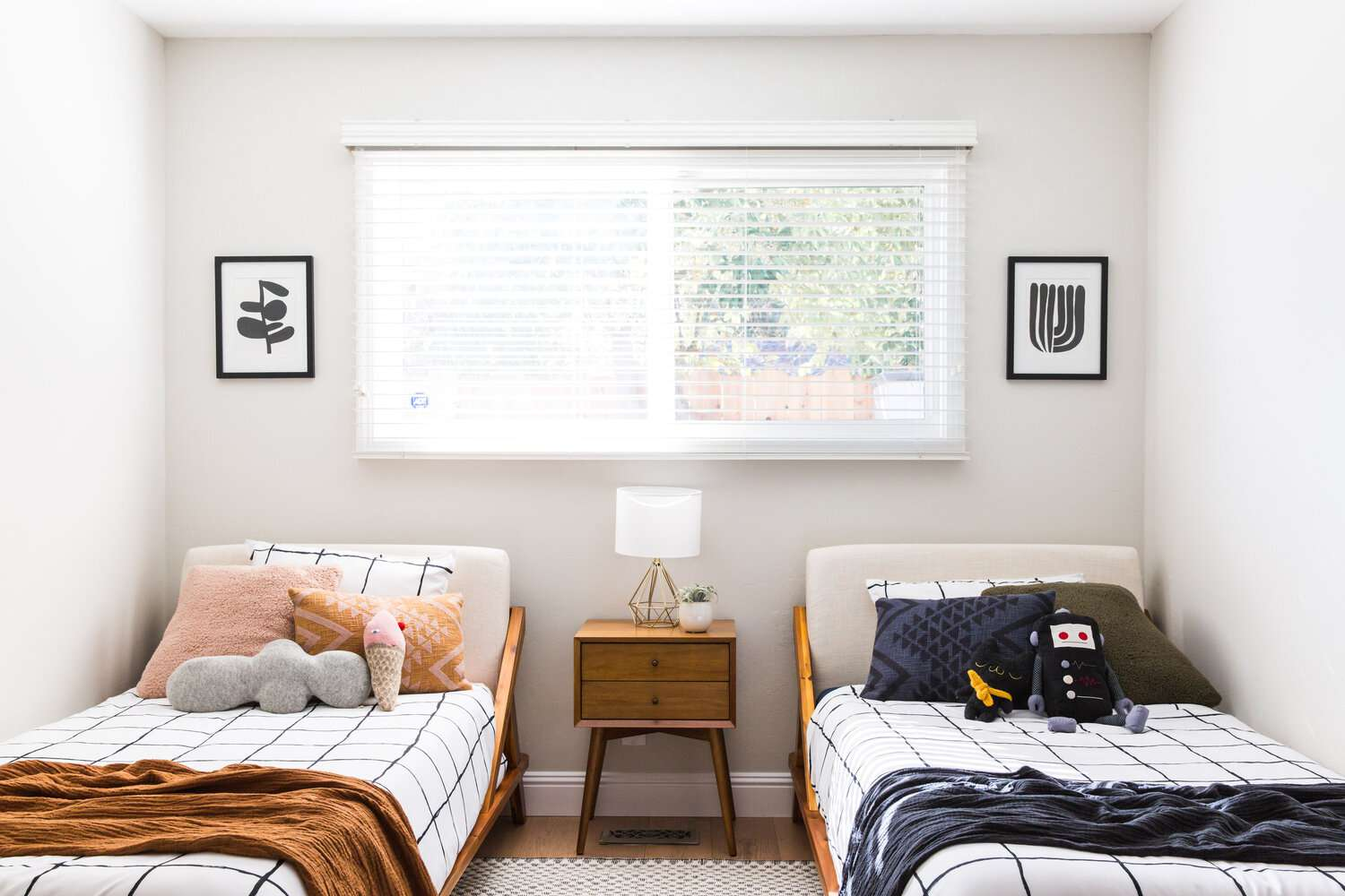 bedroom with twin beds, one with blue accents and the other with orange
