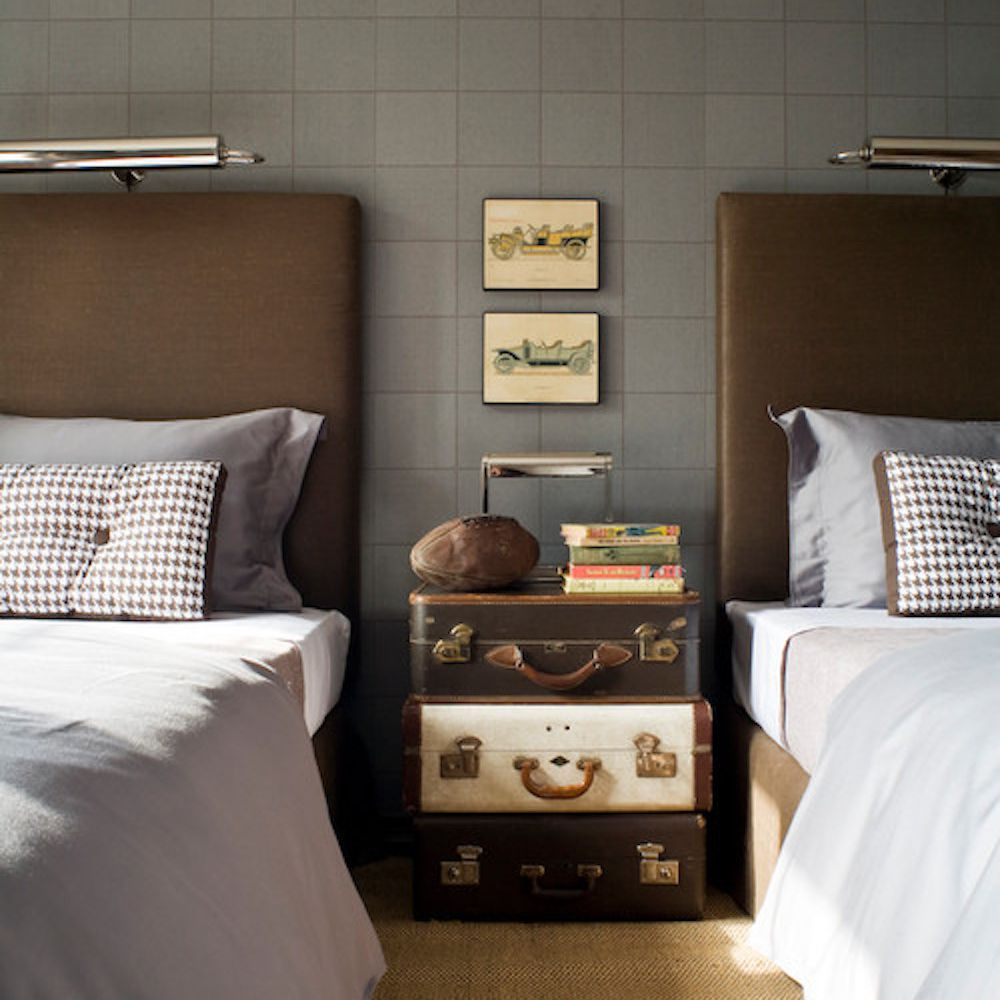 suitcase end table by bed
