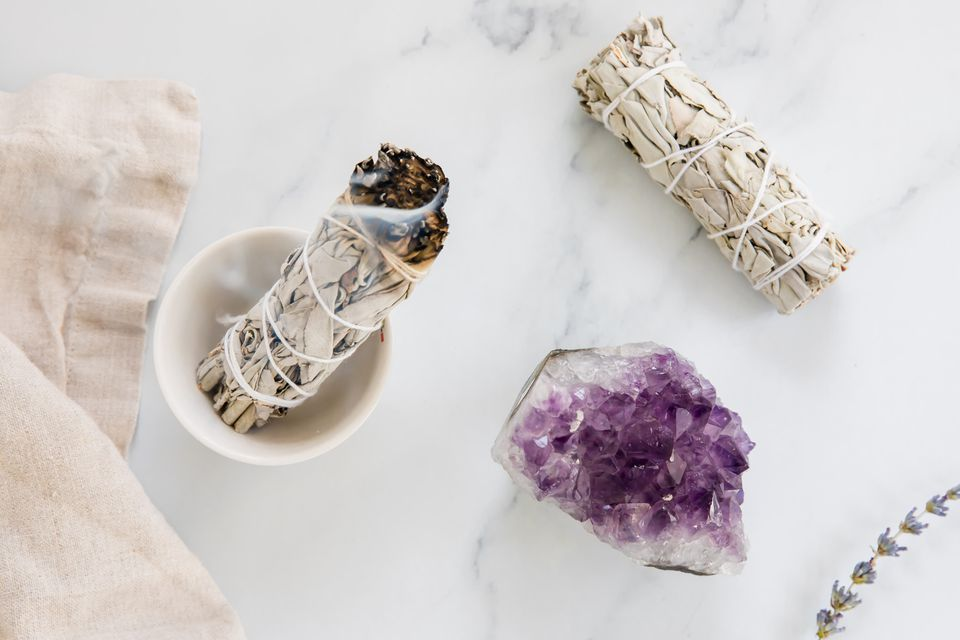 smudging to cleanse a crystal