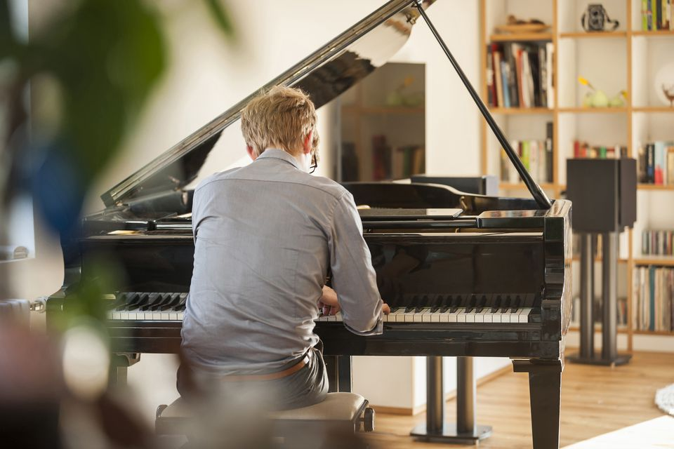 Man playing grand piano