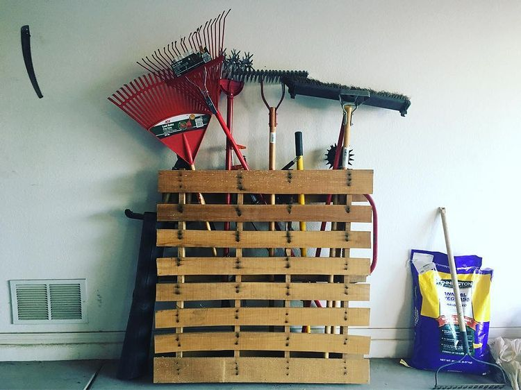 A wood pallet with tools