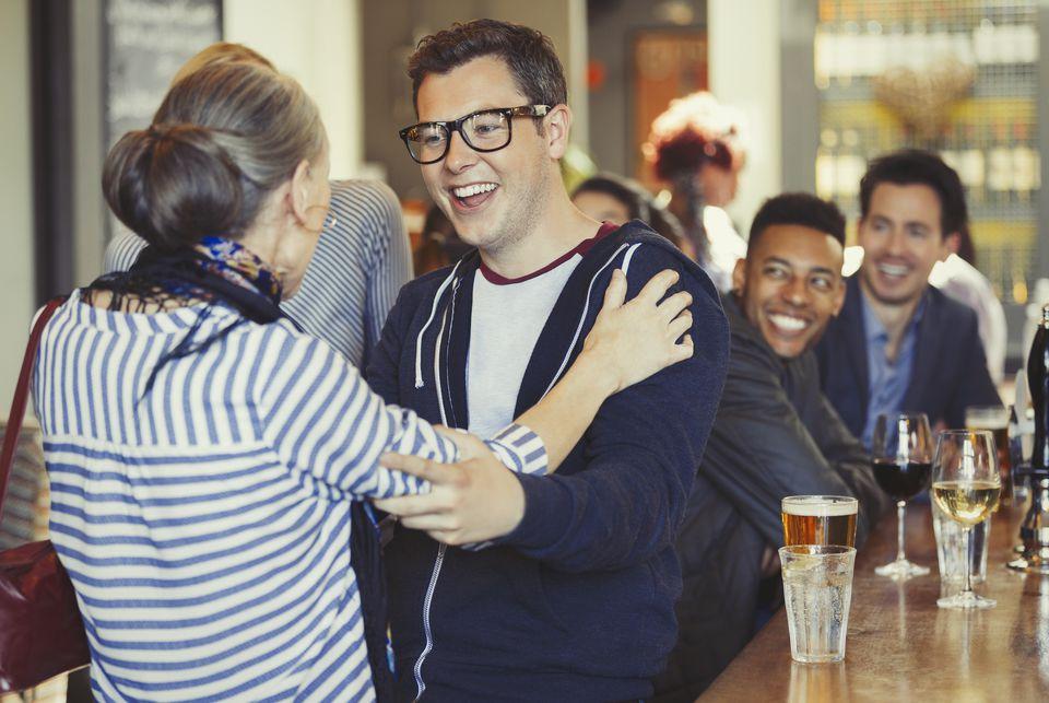 Man and woman meeting at bar