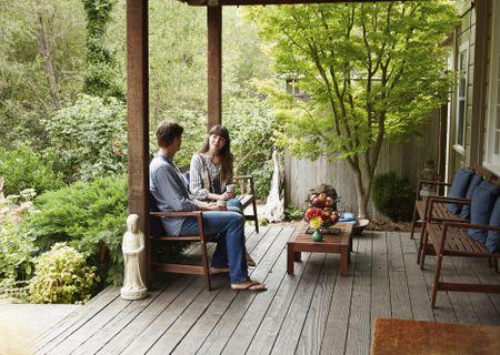 Caucasian Talking On Wooden Patio
