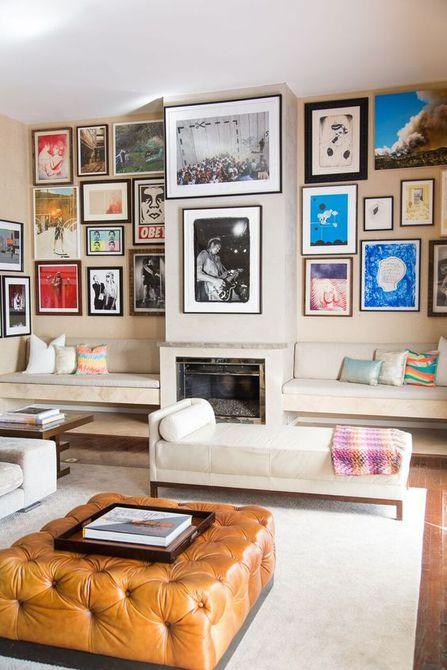Pared de la galería con colores cálidos en el arte para iluminar una sala de estar