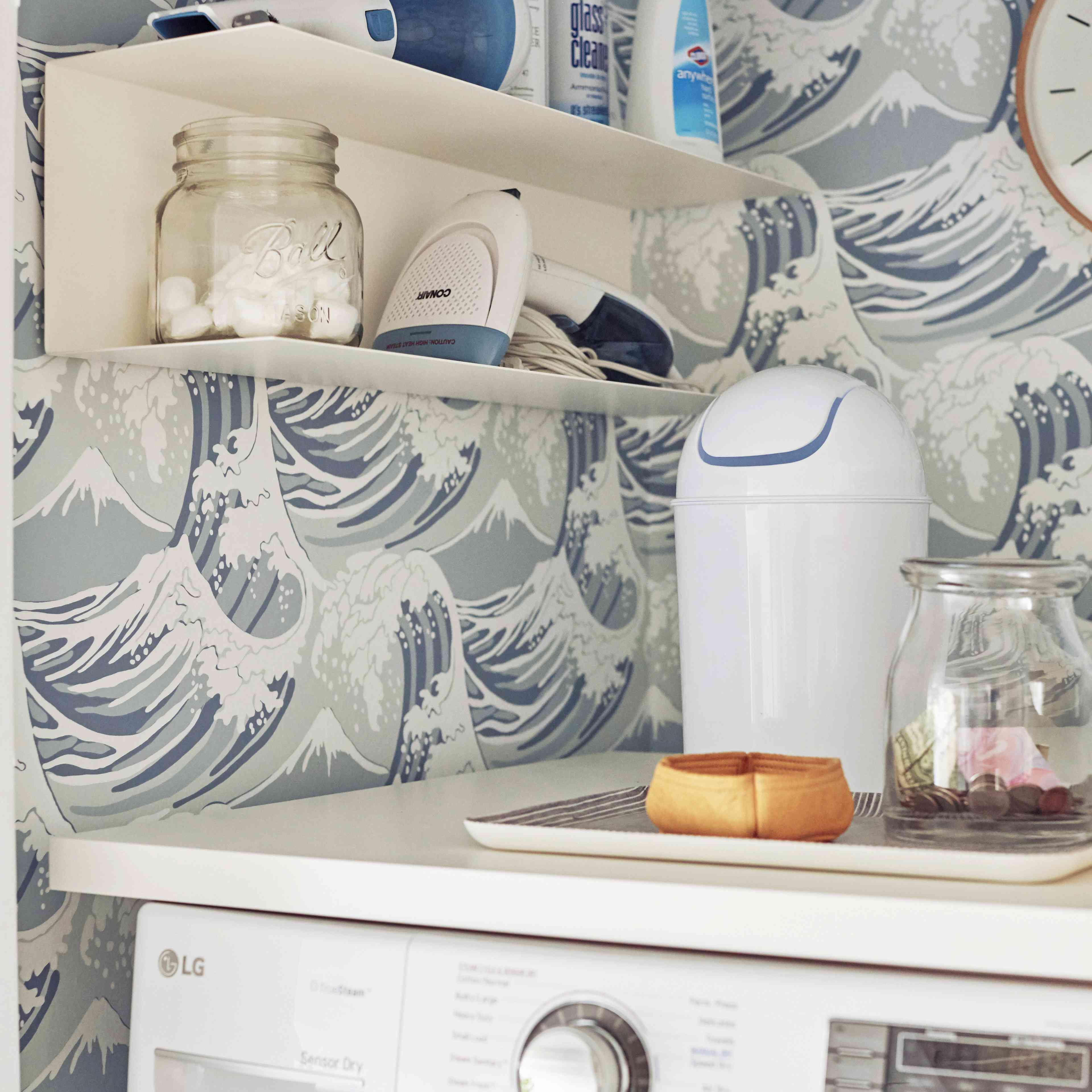 Laundry room with wave wallpaper
