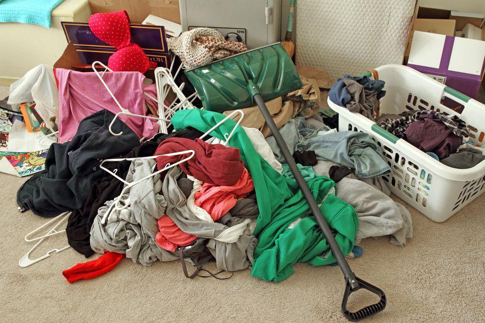 Clutter mess on a bedroom floor