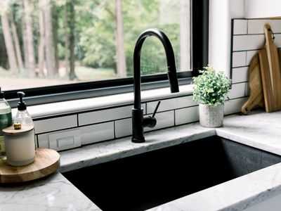 matte black faucet on a kitchen sink