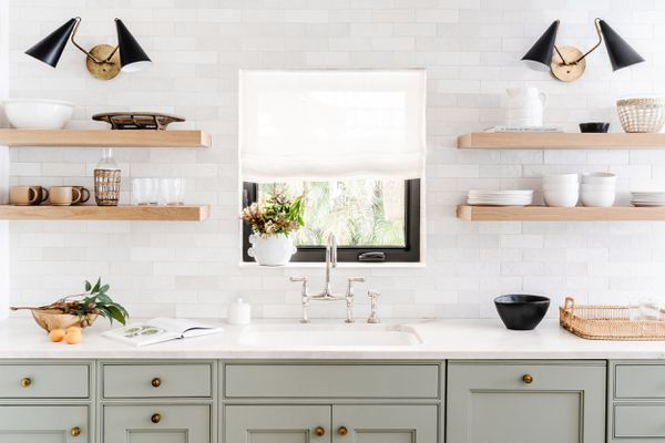 kitchen with floating shelves and calming colors
