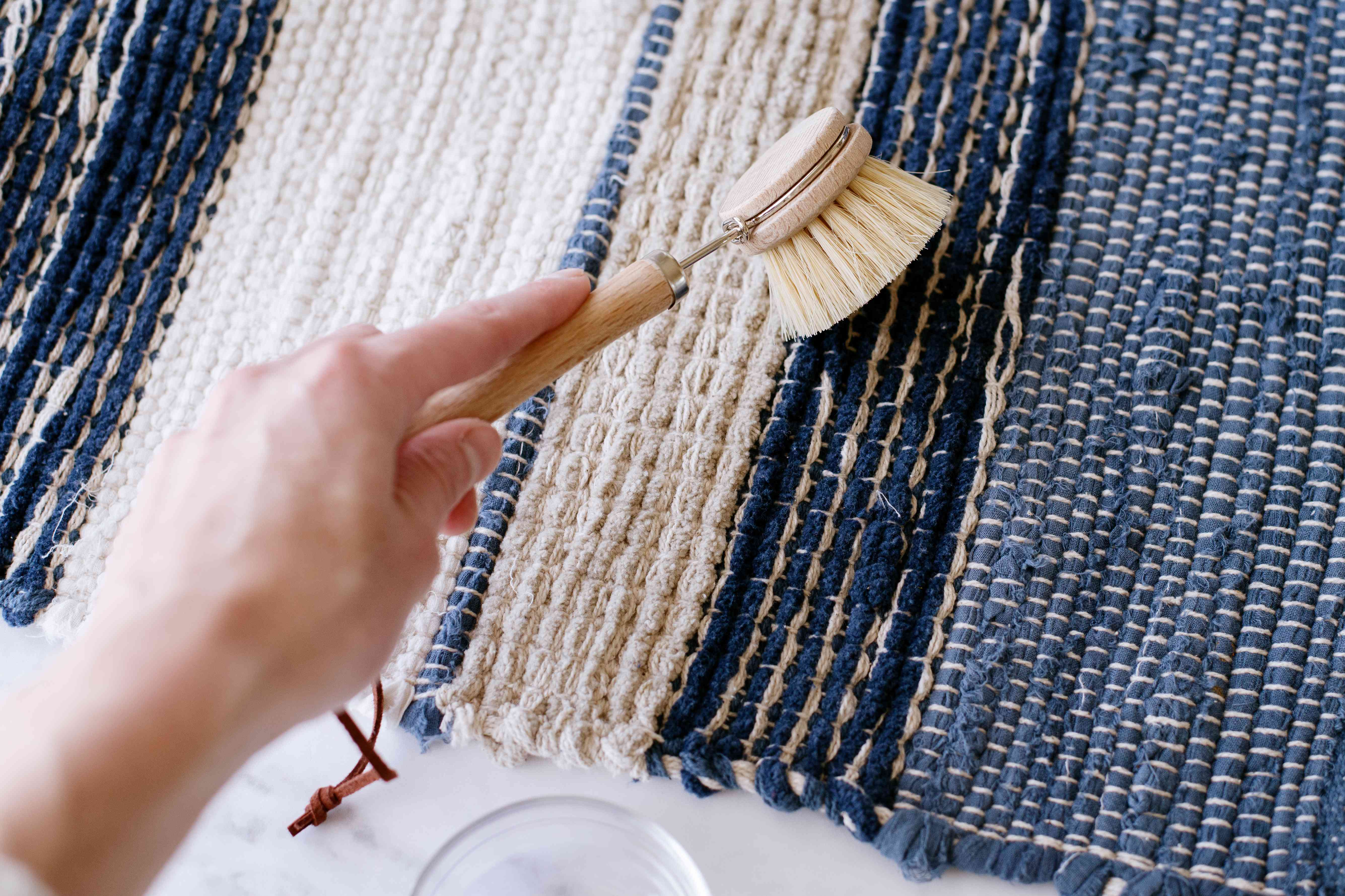 Throw rug rubbed by soft bristle brush