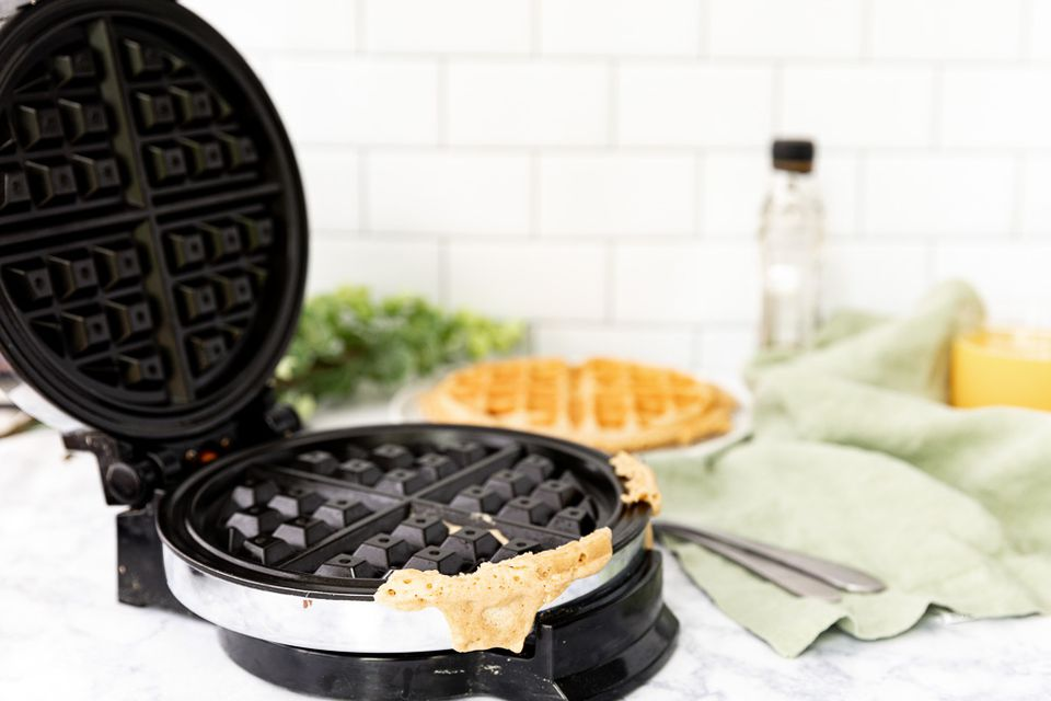 waffle iron with batter stuck to the sides