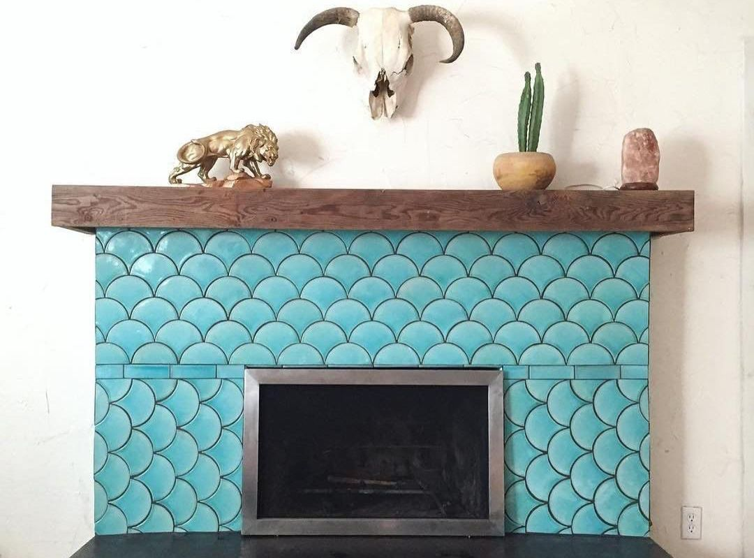 Fish scale tile fireplace with mantle.