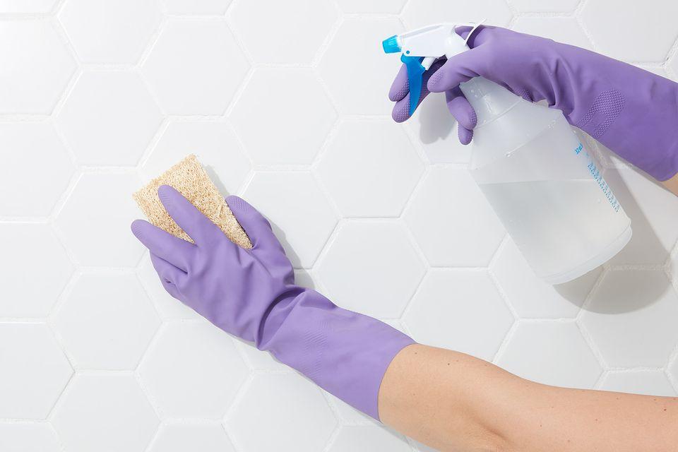 using bleach to clean a bathroom wall