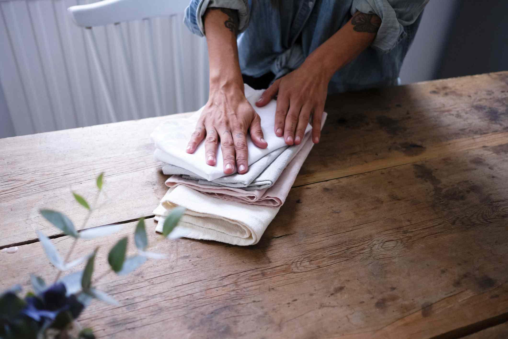 woman folding napkins