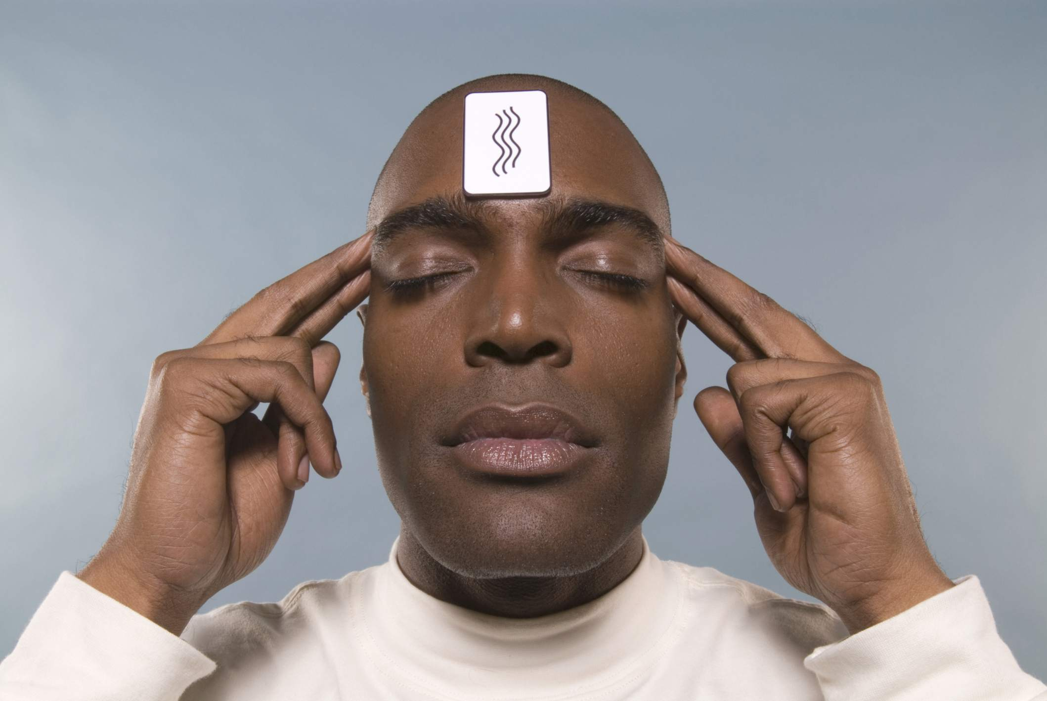 A man with an ESP card on his forehead
