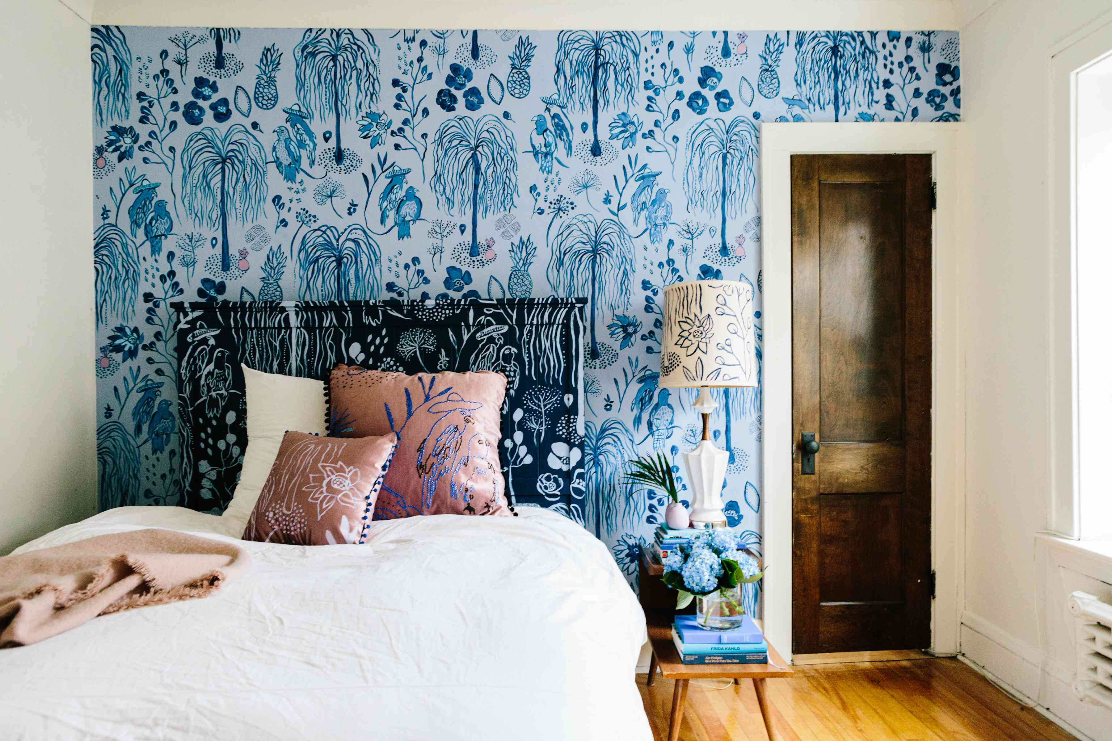 Bedroom with blue Paco Y Maria wallpaper by She She.