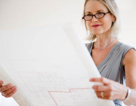 Woman looking at house floor plan