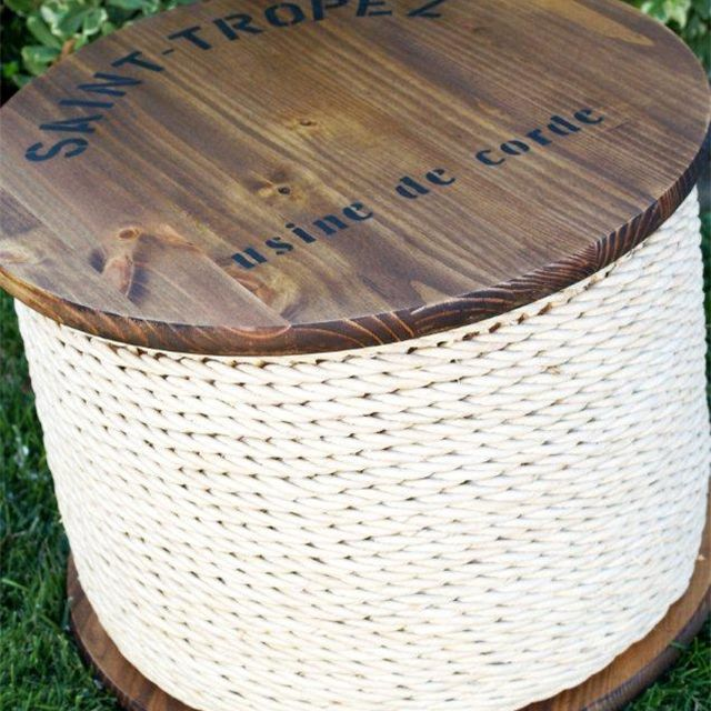 A stained spool with rope around it