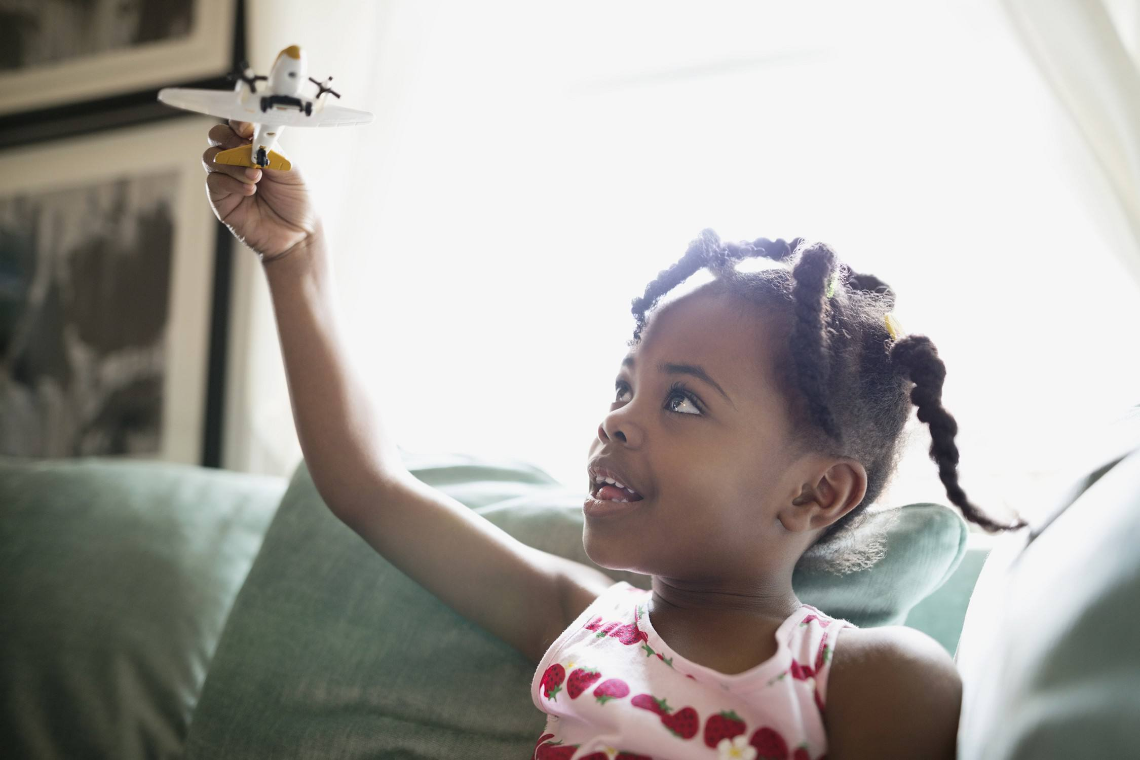 child playing with a toy airplane